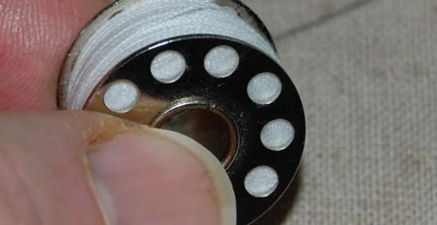 comment positionner une canette de machine à coudre