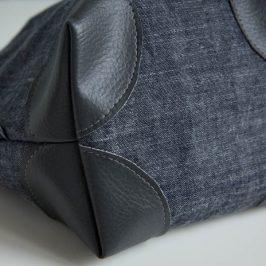 Coudre un coin de sac sur un ouvrage